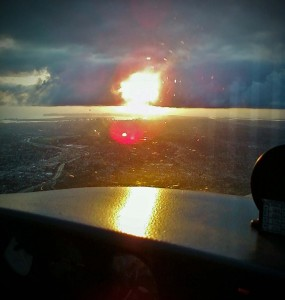 Breaking out of the clouds on the ILS 28R at MYF, just before sunset.
